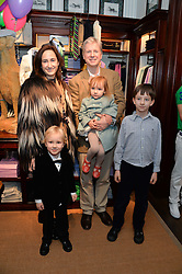 HENRY WICKHAM and SOPHIE KINSELLA with their children (L-R) REX WICKHAM, SYBELLA WICKHAM and OSCAR WICKHAM at the 4th birthday party for Amadeus Becker, son of Boris & Lilly Becker held at Ralph Lauren, 143 New Bond Street, London on 9th February 2014.