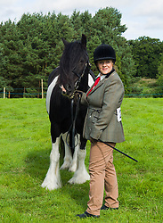 © Licensed to London News Pictures.29/08/15<br /> Bilsdale, UK. <br /> <br /> A competitor waits with her horse ahead of competing during the 105th Bilsdale Country Show in North Yorkshire.<br /> <br /> Photo credit : Ian Forsyth/LNP
