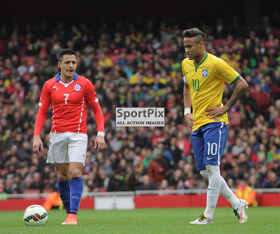Alexis Sanchez of Arsenal and his ex Barcelona team mate Neymar During the game between Chile and Brazil on Sunday 29th March 2015