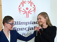 Kinga Baranowska - Polish mountaineer and Special Olympics Ambassador poses to photo with disability athlete during 30 years anniversary of The Special Olympics Poland at Presidential Palace in Warsaw on March 18, 2015.<br /> <br /> Poland, Warsaw, March 18, 2015<br /> <br /> For editorial use only. Any commercial or promotional use requires permission.<br /> <br /> Mandatory credit:<br /> Photo by © Adam Nurkiewicz / Mediasport
