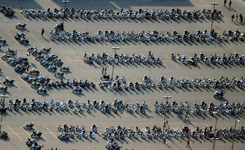 An aerial view of the parking for motorcycles in downtown Milwaukee August 30, 2003, site of the Harley-Davidson celebration.  The legendary American motorcycle company is celebrating its 100th anniversary over four days.     REUTERS/Allen Fredrickson