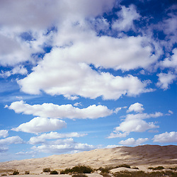 Cumulous clouds over the Kelso Sand Dunes. Mojave National Preserve, CA.