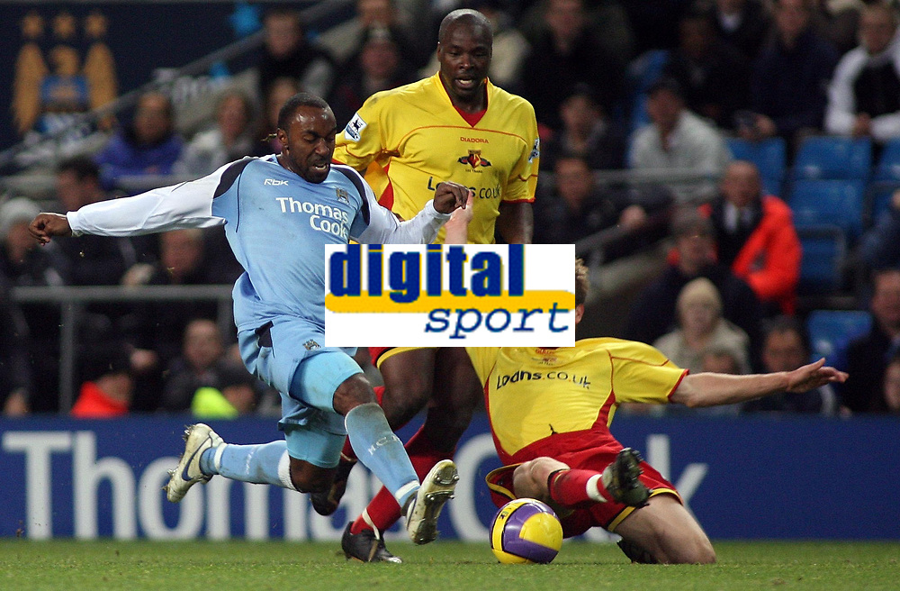 Photo: Paul Thomas.<br /> Manchester City v Watford. The Barclays Premiership. 04/12/2006.<br /> <br /> Darius Vassell (L) of Man City and Jay Demerit (R) of Watford go for the ball.
