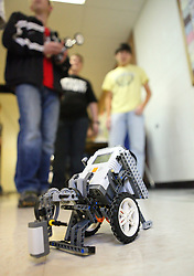 """February 28, 2011: A """"robot"""" on wheels is seen in the hallways of Bridgeport High School where members of Robotics Club compete in trying to get their vehicle to complete courses by programming them with different instructions. (Photo by: Ben Queen)"""