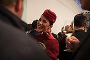 Hostess wearing the new uniform attends the cocktail party of Alitalia Day, in Milan, May 19, 2016. The new uniforms are created by fashion designer Ettore Bilotta. &copy; Carlo Cerchioli<br /> <br /> Una hostess Alitalia che indossa la nuova divisa al cocktail di Alitalia Day, Milano 19 Maggio 2016. Le nuove divise sono state create dallo stilista Ettore Bilotta.