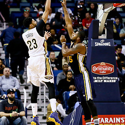 Feb 10, 2016; New Orleans, LA, USA; New Orleans Pelicans forward Anthony Davis (23) shoots over Utah Jazz forward Derrick Favors (15) during the second half of a game at the Smoothie King Center. The Pelicans defeated the Jazz 100-96. Mandatory Credit: Derick E. Hingle-USA TODAY Sports