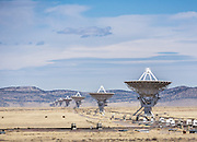 "The Karl G. Jansky Very Large Array (VLA) is one of the world's premier astronomical radio observatories. Visit the VLA on the Plains of San Agustin fifty miles west of Socorro, between the towns of Magdalena and Datil, in New Mexico, USA. US Route 60 passes through the scientific complex, which welcomes visitors. The VLA is a set of 27 movable radio antennas on tracks in a Y-shape. Each antenna is 25 meters (82 feet) in diameter. The data from the antennas is combined electronically to give the resolution of an antenna 36km (22 miles) across, with the sensitivity of a dish 130 meters (422 feet) in diameter. After being built 1973-1980, the VLA's electronics and software were significantly upgraded from 2001-2012 by at least an order of magnitude in both sensitivity and radio-frequency coverage. The VLA is a component of the National Radio Astronomy Observatory (NRAO). Astronomers using the VLA have made key observations of black holes and protoplanetary disks around young stars, discovered magnetic filaments and traced complex gas motions at the Milky Way's center, probed the Universe's cosmological parameters, and provided new knowledge about interstellar radio emission. The VLA was prominently featured in the 1997 film ""Contact,"" a classic science fiction drama film adapted from the Carl Sagan novel, with Jodie Foster portraying the film's protagonist, Dr. Eleanor ""Ellie"" Arroway, a SETI scientist who finds strong evidence of extraterrestrial life."