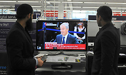 © London News Pictures. 2011/01/21 Store managers watch Tony Blair on television taking questions at The Iraq Inquiry, today (Fri). Picture credit should read Stephen Simpson/LNP