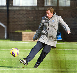 © London News Pictures. 30/11/2012. London, UK. QPR manager Harry Redknapp kicking a football during training with QPR team  at the QPR training ground in Harlington, Wes London. Photo credit: Ben Cawthra/LNP