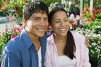 Couple Sitting Among Plants
