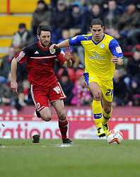 Sheffield Wednesday's Giles Coke battles for the ball with Bristol City's Cole Skuse - Photo mandatory by-line: Joe Meredith/JMP - Tel: Mobile: 07966 386802 01/04/2013 - SPORT - FOOTBALL - Ashton Gate - Bristol -  Bristol City V Sheffield Wednesday - Npower Championship