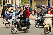 "31 MARCH 2012 - HANOI, VIETNAM:   People ride in Vietnamese ""cyclo"" taxis in traffic on Dinh Tien Hoang Street in the Old Quarter of Hanoi, Vietnam. Cyclos were common forms of transportation in the colonial era but now are used mostly by tourists.    PHOTO BY JACK KURTZ"