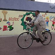 Morocco , Casablanca ,  people walking in front of mural paintings,