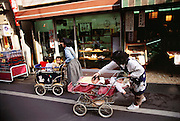 Nursery prams on a street in Kodaira City, outside Tokyo, Japan. Material World Project. The Ukita family lives in a 1421 square foot wooden frame house in a suburb northwest of Tokyo called Kodaira City.