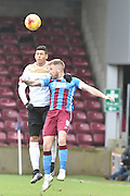 Paddy Madden of Scunthorpe United and Matthew Briggs of colchester United  during the Sky Bet League 1 match between Scunthorpe United and Colchester United at Glanford Park, Scunthorpe, England on 23 January 2016. Photo by Ian Lyall.