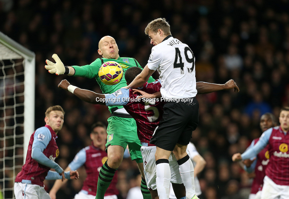 20th December 2014 - Barclays Premier League - Aston Villa v Manchester United - James Wilson of Manchester United gets a header on target only to see it saved by Aston Villa keeper Brad Guzan - Photo: Paul Roberts / Offside.