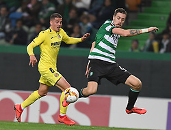 LISBON, Feb. 15, 2019  Sebastian Coates (R) of Sporting vies with Pablo Fornals of Villarreal during the UEFA Europa League round of 32 first leg soccer match between Sporting CP and Villarreal in Lisbon, Portugal, on Feb. 14, 2019. Villarreal won 1-0. (Credit Image: © Xinhua via ZUMA Wire)
