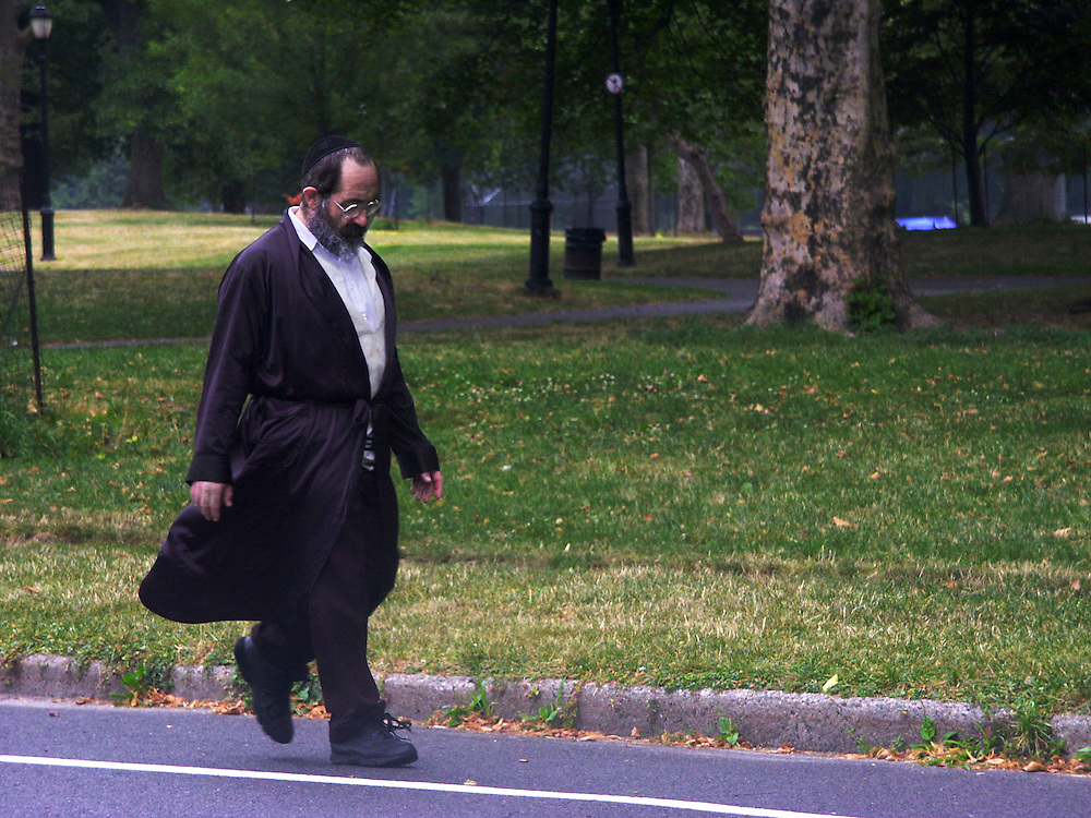 A man taking a lonely walk in the park on the Sabbath --  Saturday in this case.