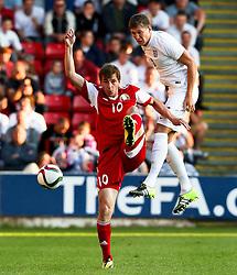 John Stones of England wins a header - Photo mandatory by-line: Matt McNulty/JMP - Mobile: 07966 386802 - 11/06/2015 - SPORT - Football - Barnsley - Oakwell Stadium - England U21 v Belarus U21 - International Friendly U21s