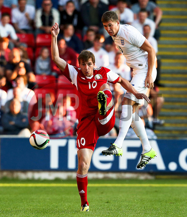 John Stones of England wins a header - Photo mandatory by-line: Matt McNulty/JMP - Mobile: 07966 386802 - 11/06/2015 - SPORT - Football - Barnsley - Oakwell Stadium - England U21 v Belarus U21 - International Friendly U21s