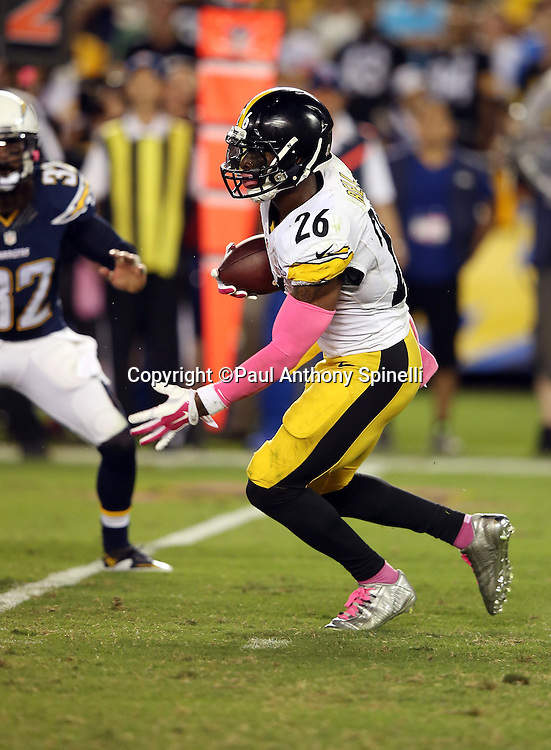Pittsburgh Steelers running back Le'Veon Bell (26) runs for a gain of 32 yards to the San Diego Chargers 41 yard line with less than two minutes left in the second quarter during the 2015 NFL week 5 regular season football game against the San Diego Chargers on Monday, Oct. 12, 2015 in San Diego. The Steelers won the game 24-20. (©Paul Anthony Spinelli)