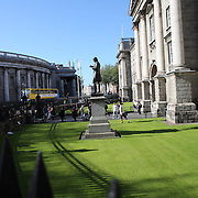 The statue of Oliver Goldsmith outside Trinity College, Dublin. (Irish: Coláiste na Tríonóide), formally known as the College of the Holy and Undivided Trinity of Queen Elizabeth near Dublin, is the sole constituent college of the University of Dublin in Ireland. The college was founded in 1592. It is one of the seven ancient universities of Britain and Ireland, as well as Ireland's oldest university. Dublin, Ireland. Photo Tim Clayton