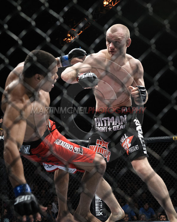 """DUBLIN, IRELAND, JANUARY 17, 2009: Alexandre Barros (left) falls to the canvas after a punch from Martin Kampmann during """"UFC 93: Franklin vs. Henderson"""" inside the O2 Arena in Dublin, Ireland"""