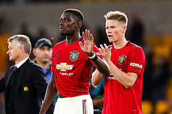 Paul Pogba of Manchester United waves apologetically to the Manchester United fans at full time after missing a penalty - Mandatory by-line: Robbie Stephenson/JMP - 19/08/2019 - FOOTBALL - Molineux - Wolverhampton, England - Wolverhampton Wanderers v Manchester United - Premier League