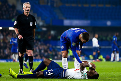 Eden Hazard of Chelsea makes sure Serge Aurier of Tottenham Hotspur is okay after a collision - Mandatory by-line: Robbie Stephenson/JMP - 24/01/2019 - FOOTBALL - Stamford Bridge - London, England - Chelsea v Tottenham Hotspur - Carabao Cup