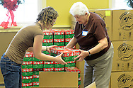 Shari Mills (l) of Langhorne, Pennsylvania and Beth Freeman of Langhorne, Pennsylvania load shoebox packed gifts into boxes during Operation Christmas Child's National Collection Week Thursday November 19, 2015 in Langhorne, Pennsylvania.  (Photo by William Thomas Cain/Cain Images)