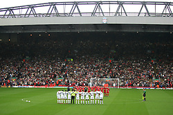 LIVERPOOL, ENGLAND - SUNDAY MARCH 27th 2005: Liverpool Legends and Celebrity XI players stand for a minutes silence in memory of the victims of the Asian Tsunami during the Tsunami Soccer Aid match at Anfield. (Pic by David Rawcliffe/Propaganda)