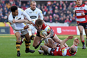 Gloucester fly-half / flanker Jason Woodward tackled during the Aviva Premiership match between Gloucester Rugby and Wasps at the Kingsholm Stadium, Gloucester, United Kingdom on 24 February 2018. Picture by Alan Franklin.