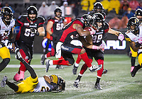 Running Back Mossis Madu Jr. (#37) jumps a tackle during the CFL match between the Ottawa RedBlacks and the Hamilton TigerCats at TD Place Stadium in Ottawa, ON. Canada on Oct. 21, 2016.<br />