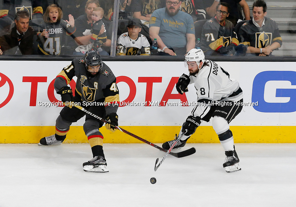 LAS VEGAS, NV - APRIL 11: Vegas Golden Knights left wing Pierre-Edouard Bellemare (41) and Los Angeles Kings defenseman Drew Doughty (8) skates for the puck during Game One of the Western Conference First Round of the 2018 NHL Stanley Cup Playoffs between the L.A. Kings and the Vegas Golden Knights Wednesday, April 11, 2018, at T-Mobile Arena in Las Vegas, Nevada. (Photo by: Marc Sanchez/Icon Sportswire)