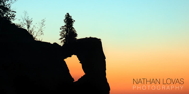 Tettegouche arch sillouette at sunset;  North Shore, Minnesota.