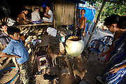 Phu Quoc Island. Ong Lang Beach. A family having dinner in their hut near the beach.