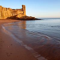 St Andrews Castle and Castle Sands at Sunrise St Andrews Fife Scotland