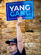 27 APRIL 2019 - STUART, IOWA: A volunteer for Andrew Yang's campaign to be the Democratic nominee for the US Presidency listens to Yang's speech at the Reaching Rural Voters Forum in Stuart. The forum was an outreach by Democrats in Iowa's 3rd Congressional District to mobilize Democratic voters statewide. Iowa saw one of the largest shifts from Democrats to Republicans in the 2016 Presidential election and Trump won the state by double digits. Republicans control the governor's office and both chambers of the Iowa legislature. Iowa traditionally hosts the the first selection event of the presidential election cycle. The Iowa Caucuses will be on Feb. 3, 2020.                                   PHOTO BY JACK KURTZ