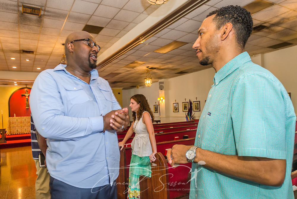 Urban Hope Community Church pastor Alton Hardy talks with church treasurer Dion Watts after the Sunday service, July 19, 2015, in Fairfield, Ala. In the background is church member Emily Sadler. (Photo by Carmen K. Sisson/Cloudybright)