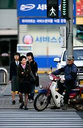 SOUTH KOREA MASAN 29OCT07 - Pedestrians at a crossing in downtown of the port city of Masan, south Korea...jre/Photo by Jiri Rezac..© Jiri Rezac 2007..Contact: +44 (0) 7050 110 417.Mobile:  +44 (0) 7801 337 683.Office:  +44 (0) 20 8968 9635..Email:   jiri@jirirezac.com.Web:    www.jirirezac.com..© All images Jiri Rezac 2007 - All rights reserved.