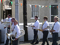 Band in religious procession in Cork Ireland image for editorial use only