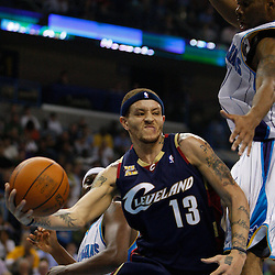 Mar 24, 2010; New Orleans, LA, USA; Cleveland Cavaliers guard Delonte West (13) looks to pass as New Orleans Hornets guard Marcus Thornton (5) defends during the first half at the New Orleans Arena. Mandatory Credit: Derick E. Hingle-US PRESSWIRE