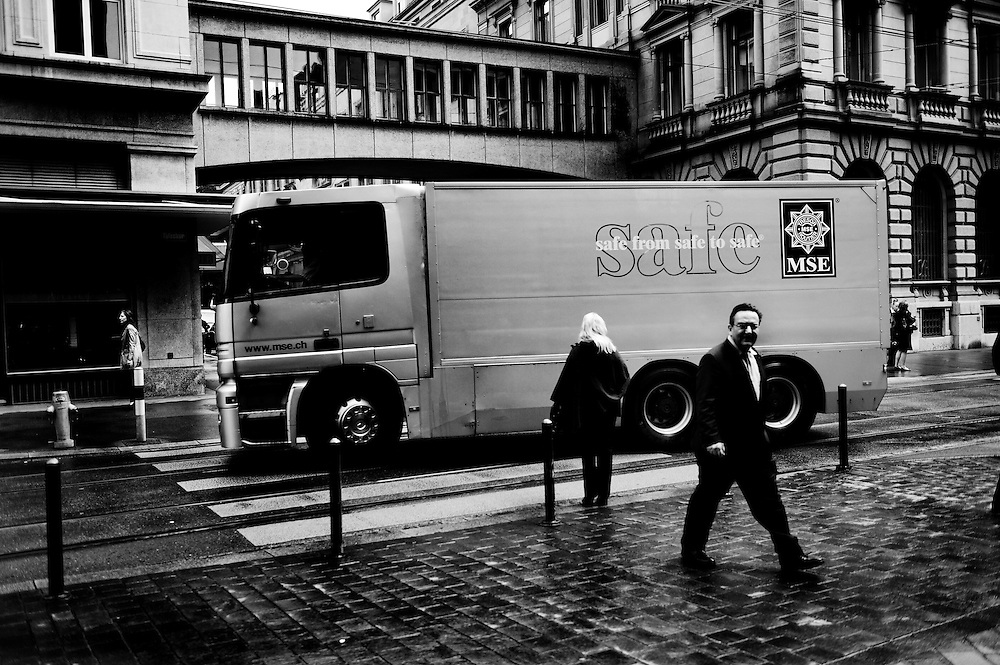 Giant armoured vehicle in Zurich's main banking district. HQ of Credit Suissse behind.