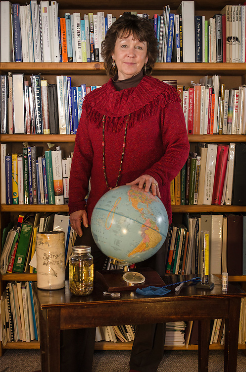 Denise Rue-Pastin, director of the Water Information Program in southwestern Colorado, displays a variety of water education tools at her office in Pagosa Springs, Colorado.