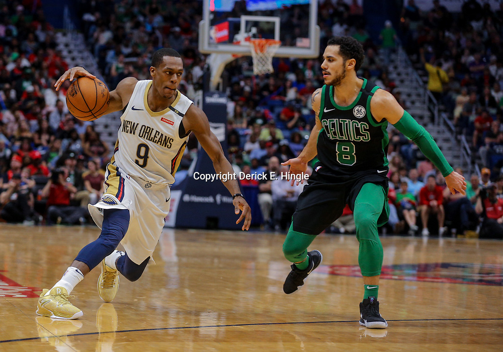 Mar 18, 2018; New Orleans, LA, USA; New Orleans Pelicans guard Rajon Rondo (9) drives past Boston Celtics guard Shane Larkin (8) during the second quarter at the Smoothie King Center. Mandatory Credit: Derick E. Hingle-USA TODAY Sports