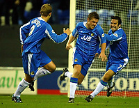 Photo. Aidan Ellis.<br />Wigan Athletic v Stoke City.<br />Nationwide Division 1.<br />14/10/2003.<br />Wigan's Geoff Horsfield (centre) Turns to celebrate his equalsing goal