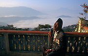 """The rare Victoria Cross is worn on the chest of the celebrated Nepali war veteran Bhanu Bhagta Gurung (also written Bhanubhakta), an ex-soldier of the British Gurkha regiment who in the second world war, earned his medals from repeated bravery against Japanese positions in Burma. He sits here on the terrace of his home, above the misty valley of Gorkha, Central Nepal. He is one of the last survivors of the remarkably brave men  who helped defeat the enemy in the jungles of south-east Asia. Gurung is the name of his Nepalese tribe (like the Sherpas who also come from the high Himalayan Kingdom). His company commander described him as """"a smiling, hard-swearing and indomitable soldier who in a battalion of brave men was one of the bravest"""". Born September 1921 - died March 1 2008."""
