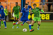 Mike Jones (#8) of Carlisle United FC shields the ball from Kyle Taylor (#28) of Forest Green Rovers during the The FA Cup match between Carlisle United and Forest Green Rovers at Brunton Park, Carlisle, England on 10 December 2019.