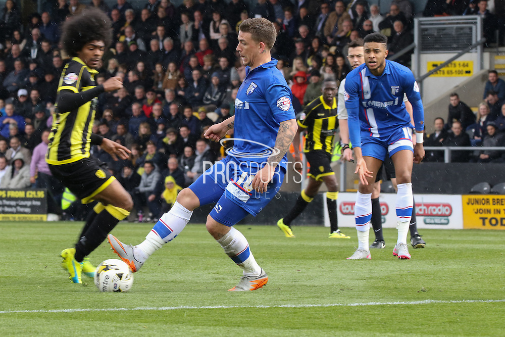 Gillingham forward Cody McDonald is brave in a challenge during the Sky Bet League 1 match between Burton Albion and Gillingham at the Pirelli Stadium, Burton upon Trent, England on 30 April 2016. Photo by Aaron  Lupton.