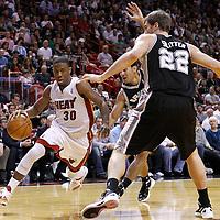 17 January 2012: Miami Heat point guard Norris Cole (30) drives past San Antonio Spurs guard Cory Joseph (5) and San Antonio Spurs forward Tiago Splitter (22) during the Miami Heat 120-98 victory over the San Antonio Spurs at the AmericanAirlines Arena, Miami, Florida, USA.